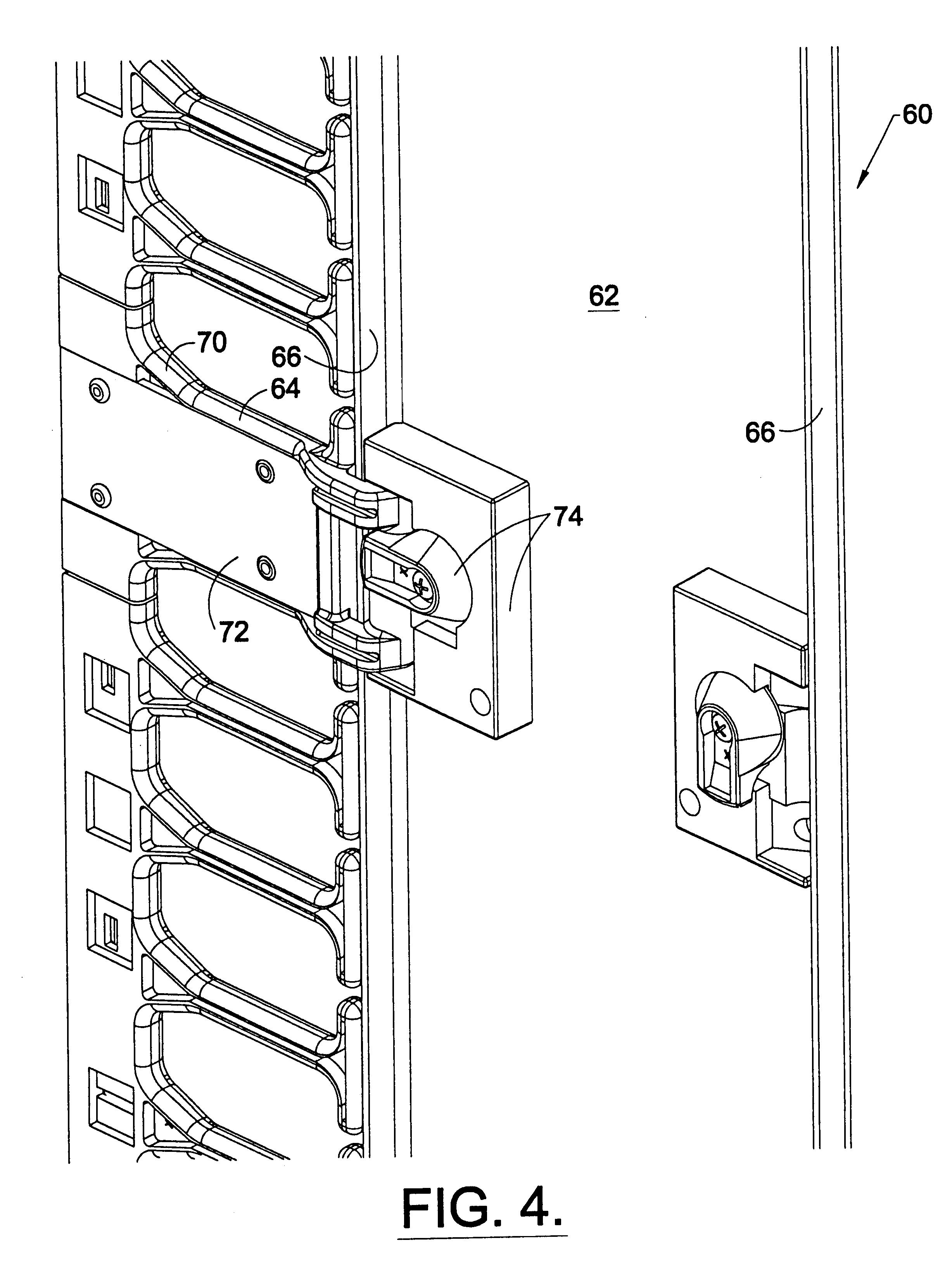 patent us6489565 - vertical cable management rack