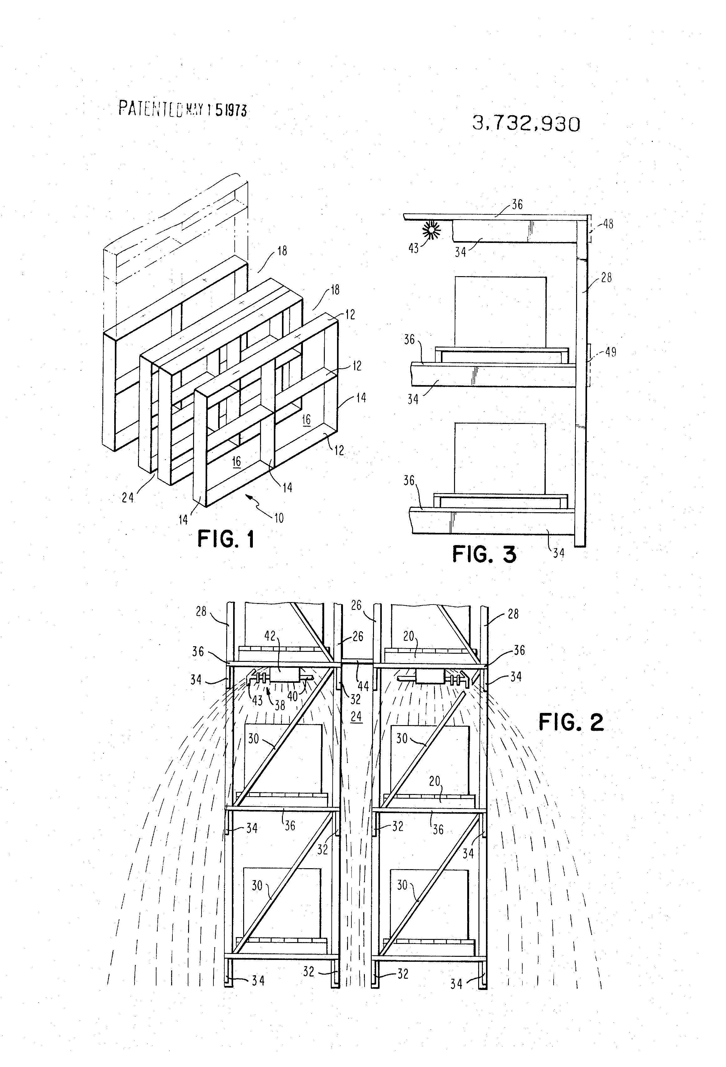 patent us3732930 - storage rack and sprinkler arrangement
