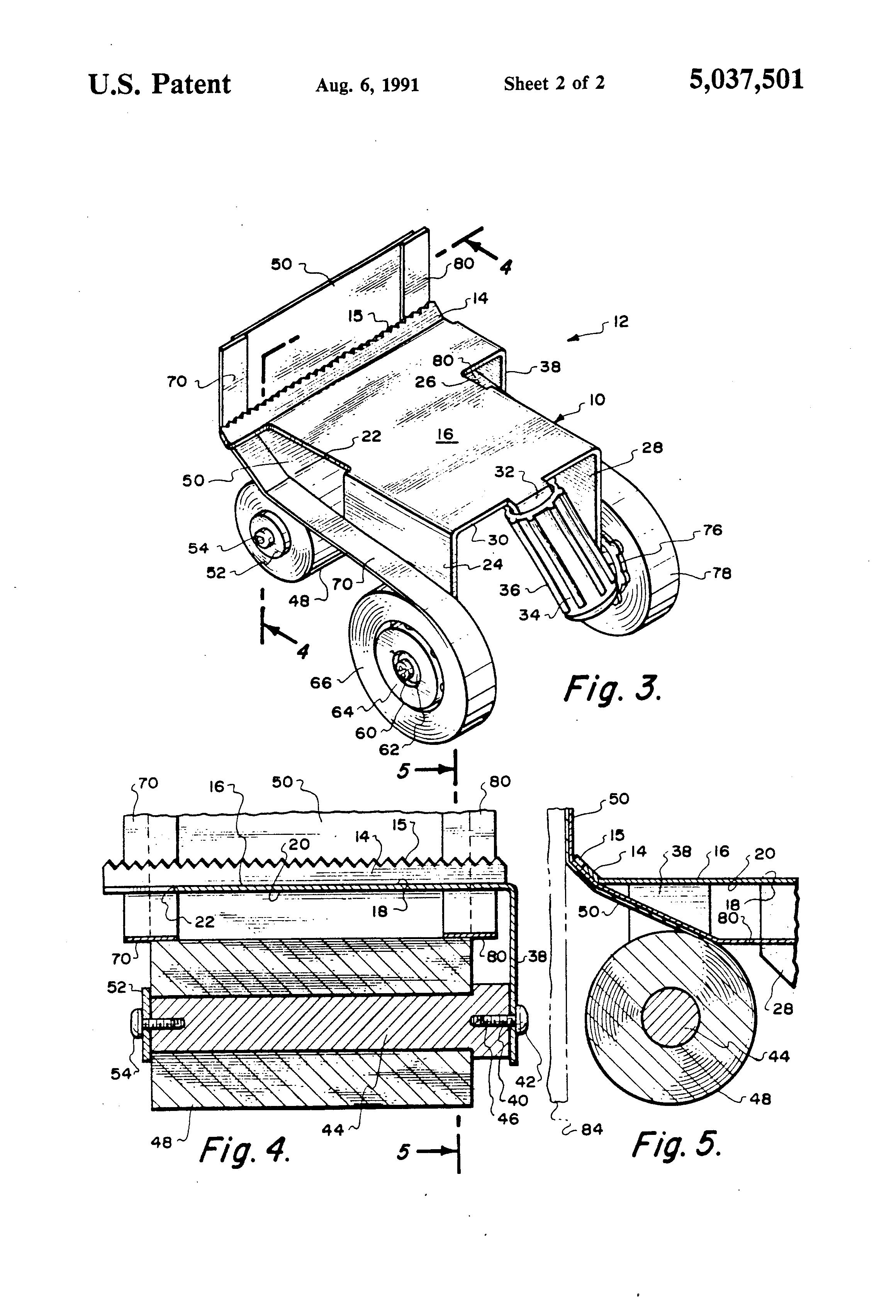 held masking machine
