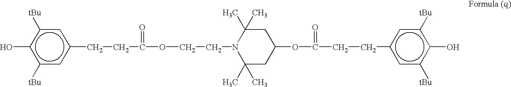 Figure US06939651-20050906-C00022