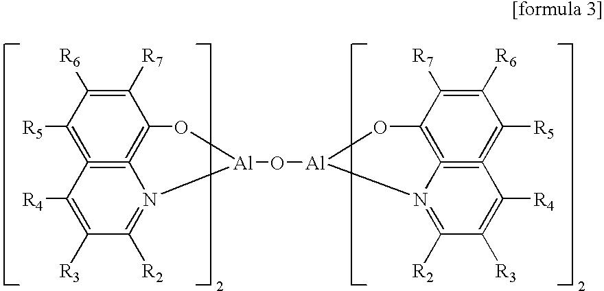 Figure US07701134-20100420-C00003