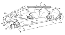 US9756782B2 - Rear discharge mower deck with flow control baffles